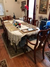 Great cherry table that seats 10.  Has 8 chairs and 2 leaves