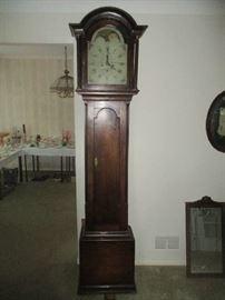 Antique grandfather clock, face of clock says John Osgood