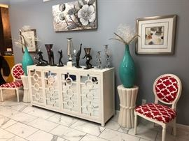 Elegant Artwork, colorful accent pieces and a large Mid-Century cabinet
