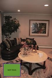 Plant, Curved Sofa, Round Marble Top Coffee Table, Art and Decorative. Rug NOT FOR SALE!!