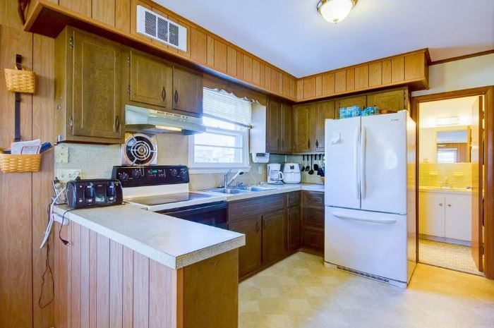 Nice kitchen cabinets for a small space. Sorry - owner took fridge.