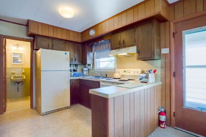 Nice kitchen cabinets for a small space. Sorry, owner took fridge.