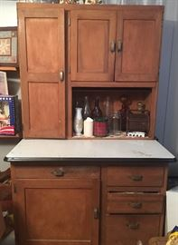 Fantastic Hoosier Cabinet with sifter and enameled surface.