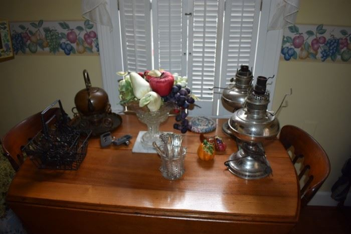 Drop Leaf Kitchen TAble adorned with Oil Lamps and other Collectible Items