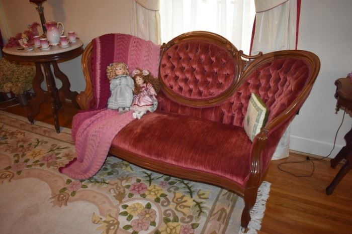 Gorgeous Red Velvet Victorian Love Seat with Tufted Back and Elegant Styling also take note of the 2 Porcelain Dolls plus the Victorian Marble Topped Table, Chocolate Set and other Collectible pieces