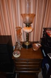 """Absolutely Gorgeous and Rare (as most of the lamps in this estate) this Aladdin Style Banquet Lamp is featuring twisted base, beautiful multi-colored and faceted bowl with Elegant fluted edged and etched Shade. Also pictured is """"Strikingly"""" Beautiful Hand Blown and Crystal Vase fluted edged Carnival Glass Bowl, Victorian Powder Box, and 4 Drawer Antique Table"""