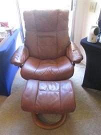 Ekornes Rust-colored Recliner with Ottoman - shows some wear