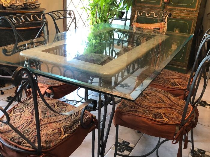 Heavy iron base dining table w/6 chairs.