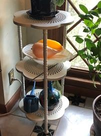 Three tiered floral shape shelving.