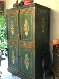 Vintage solid wood cabinet w/ hand painted designs front and sides.