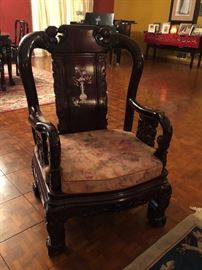 Vintage solid wood mahogany carved armed chair w/ inlaid mother of pearl design. Each chairs have a brocade fabric cushion.