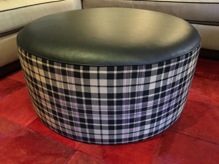 "24) Upholstered Round Ottoman in Ralph Lauren ""Upton Tartan"" and Cowhide in ""Lacar Black"". 36""d"