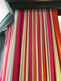 "32) Custom pleated drapery panels in three colors of linen, each 12"" wide vertical stripe. Colors Pindler's Ghent in Bone, Pindler's Jefferson in Tangerine and O&L's Brera in hot pink."