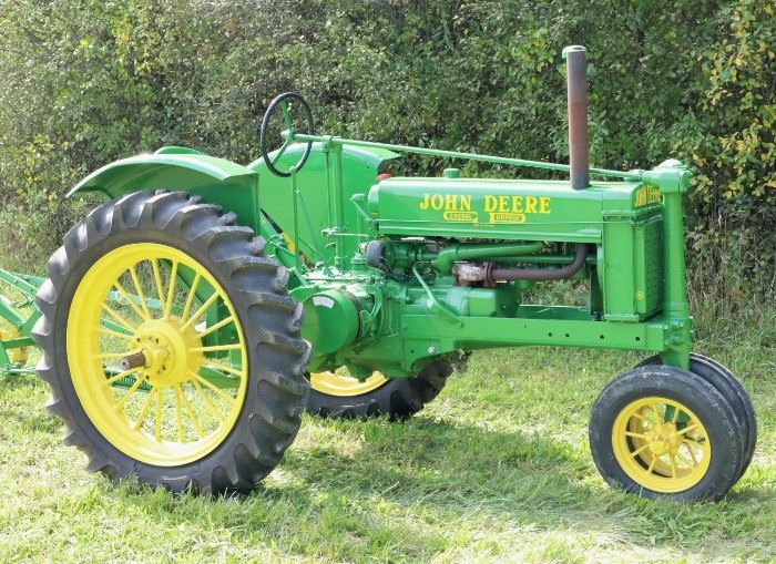 A 1937 John Deere Model B Tractor with plow.  Completely restored about 15 years ago, complete and running.  New tires, includes a vintage single bottom plow.