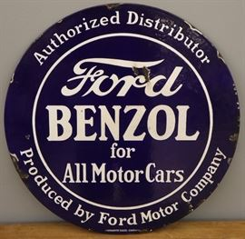 "An early 20th century Ford Motor Company Porcelain Sign.  Round, double sided sign reads ""Authorized Distributor Ford Benzol for All Motor Cars Produced by Ford Motor Company"", and marked ""Veribrite Signs Chicago"".  Wear and several chipped areas.  24"" diameter."
