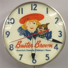 "A mid 20th century Buster Brown Shoes Advertising Clock.  Round, electric clock reads ""Buster Brown America's Favorite Children's Shoes"" on dial.  Clock runs and lights up, some wear.  14 3/4"" diameter."