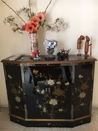 Asian-themed lacquered credenza.