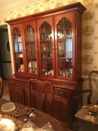 Beautiful traditional dining room set in solid cherry by Cresent—table and 6 chairs, china cabinet, and buffet. Wonderful set in excellent condition, just in time for the holidays.