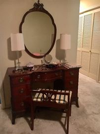 So cute! Vintage mahogany keyhole desk (or vanity). Shown with vanity bench and mirror.