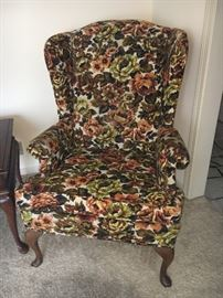 Vintage green and brown wing back chair.
