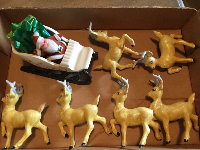 Ceramic sleigh and 6 reindeer.