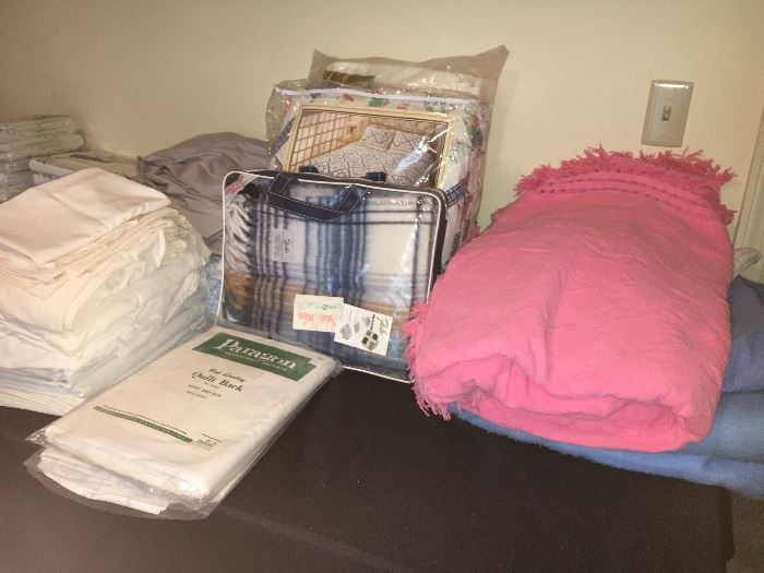 Household linens, some new in packages.