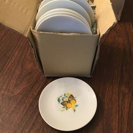 Vintage, unused and still in box—one dozen small butterfly plates.