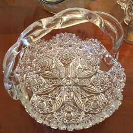 Gorgeous cut glass bowl with handle.