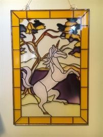 Wall decor—plastic stained glass look unicorn.