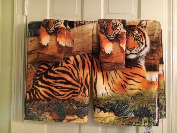 Tiger-theme bathroom linens—shower curtain, rug, towels.
