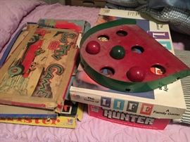 Vintage board games and metal skill ball game.