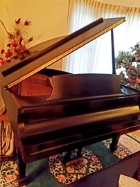 Steinway baby grand piano satin finish. Like new.