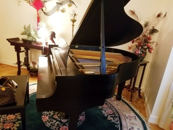 Steinway & Sons Baby Grand Piano, excellent condition. Black satin finish.