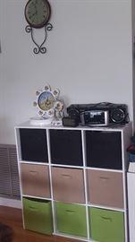 Storage Cabinet with Cloth Bind, Clocks