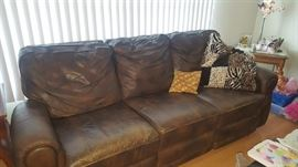 Brown Leather Couch with Recliners on each end.  Electric