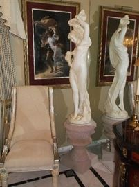 Large lady statue on marble top pedestal