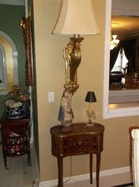 Wall mounted gold tone lamp and French side table