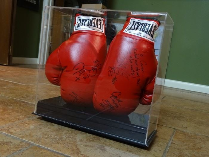 """Pair of Everlast boxing gloves with case signed by Texas band Bowling For Soup. Originally presented as a gift from the band after a 2007 SXSW filming  of their single """"Almost"""" at the Bat Bar for services rendered that resulted in the recipient being punched by a drunken drum tech who was disrupting filming.      $595.00     Contact for purchase or more information"""