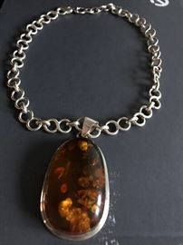 """#108.  Large AMBER piece 2.5"""" L.          Sterling Silver $650.        Sterling Silver thick Link Neck Chain  $250."""