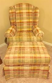 Upholstered plaid chair with ottoman