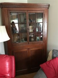 Beautiful Country corner cupboard with original wavy glass, shelves, etc.  Perfect collectors piece.