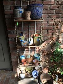 Iron Metal Shelving Unit filled with Planters