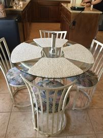 Small kitchen table with 4 chairs  glass top and metal bottom, approx 30 inch ht