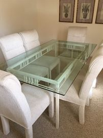 Dining room table, glass table top, beveled edge and 6 cushioned chairs   (table approx 30 inch ht, 6 foot long and 40 inch wide