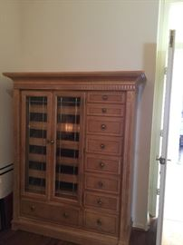 9 drawer chest with center cabinet with pull out shelves,  by Alexander Julian Home Colours   approx 49 inch wide  67 inch ht and 18 inch depth