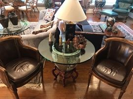 Pair of carved chairs with leather. Oriental jardiniere with glass top displaying carved soapstone and other figures