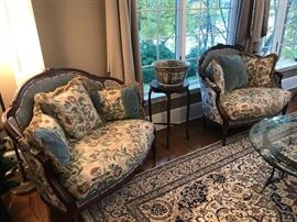 Pair of carved frame settees with carved mahogany finish stand displaying oriental porcelain bowl