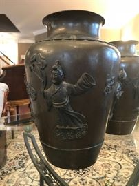 One of the pair of bronze oriental vases.