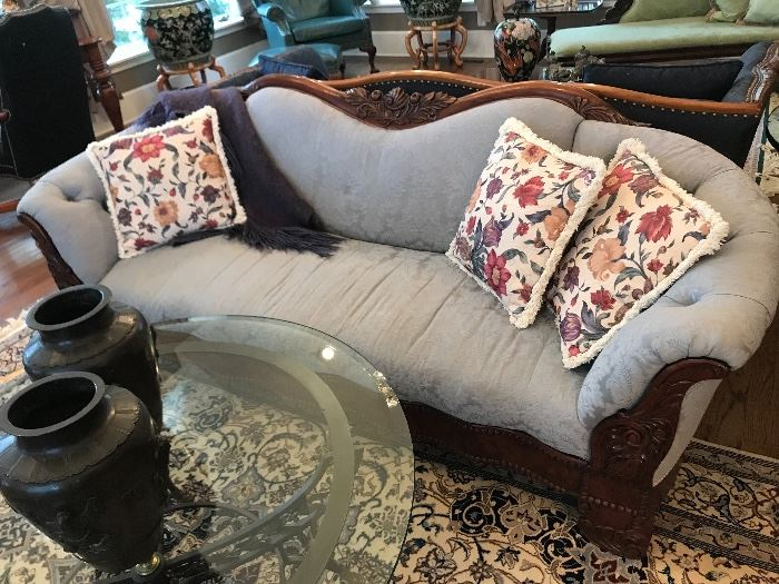 Carved sofa with damask upholstery