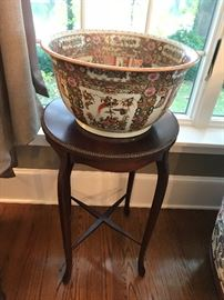 Close up of oriental bowl on small round stand